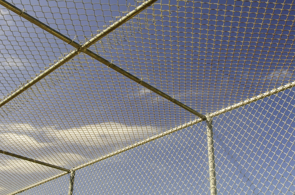 Part of batting cage by baseball field